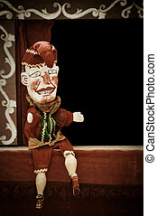 punch puppet offering on stage copy-space