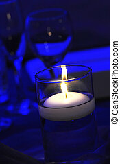 candle light - loney candle light on the dining table under...