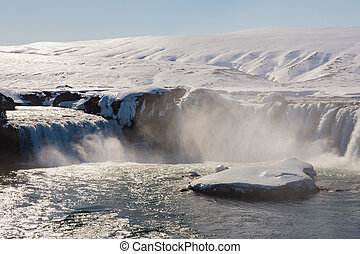 Big waterfalls in winter season, Iceland natural landscape