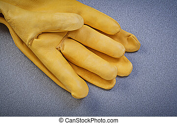 Leather safety gloves on grey background directly above...