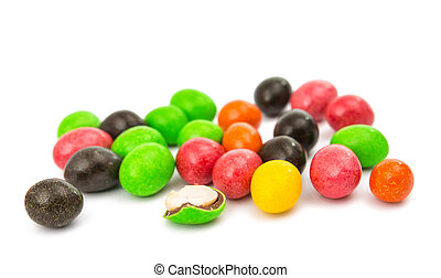 color dragees with peanuts isolated on white background