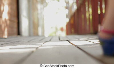 Sexy Girl In High Heels Walking On Wooden Floor - Waist down...
