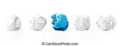 Five Paper Balls in a Row - Blue paper ball between four...