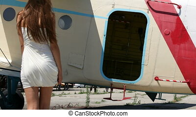 Happy Woman Comes Into The Plane - Rear shot of a beautiful...