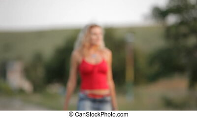 Sexy Blonde Walking On The Road - Defocused shot in the...