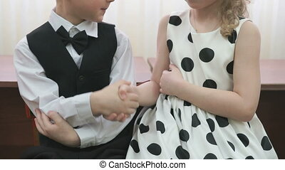 Little boy and girl holding hands at kindergarten