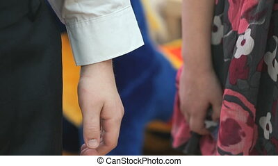 Little brother and sister holding hands at nursery - Little...
