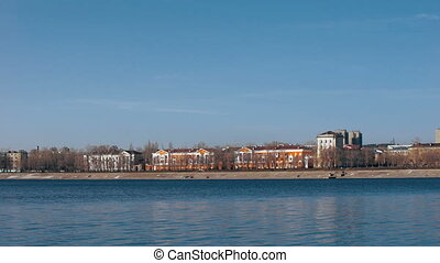Provincial town on the bank of the river. Houses of the old...