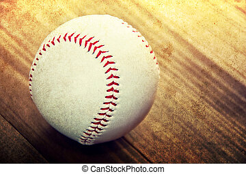 Baseball game Baseball ball on wooden background Grunge...