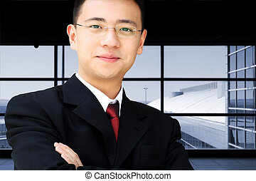 Asian business man - Handsome asian business man in suit at...