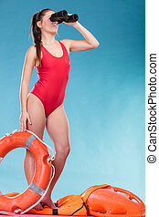 Lifeguard woman on duty with ring buoy lifebuoy - Lifeguard...