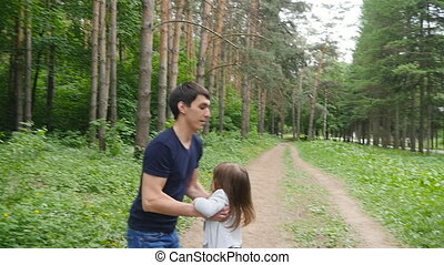 Father and his kid - daughter - playing