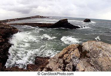 furious waves - View of a furious wave hitting the cliffs on...
