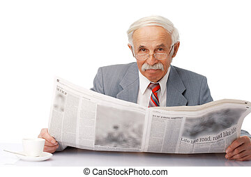Elder man reading a newspaper