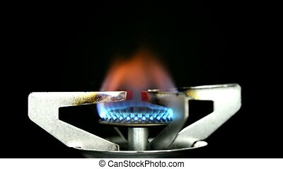 gas flame burns of an camping cooker