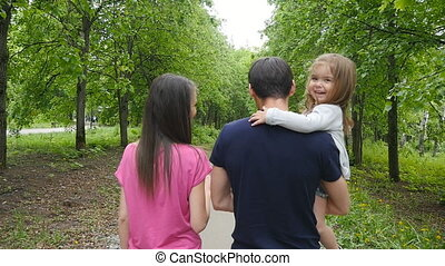 Happy Family on the Walk in Forest