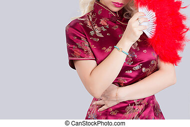 Beautiful Asian model wearing traditional Cheongsam - studio...