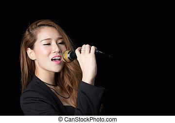 Beautiful asian woman singing - studio shot