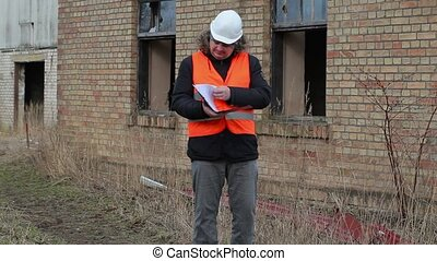 Building inspector checking documentation