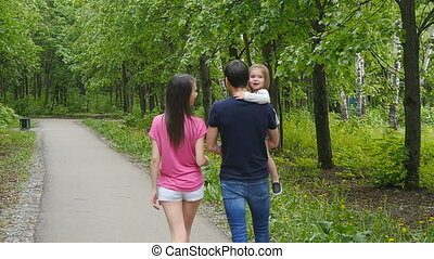 Happy Family on the Walk in Forest Father Mother Little Baby...
