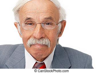 Close-up Of Smiling Elder Businessman.