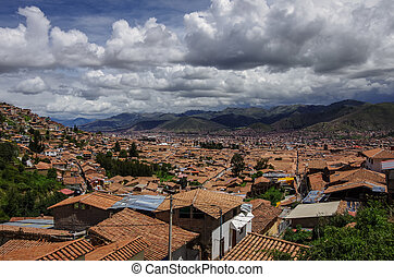 Cityscape of Cusco in Sacred Valley, Peru. A view from a fortress Saksaywaman (UNESCO World Heritage Site)