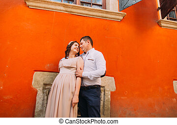 Sensual couple hugging and touching each other in front of...