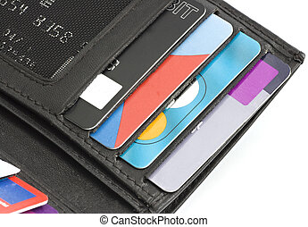 A wallet or purse containing debit and credit cards