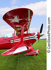 Red Biplane wing view - View down the wings of an old red...