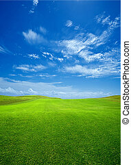 Beautiful green field - Background of clouds and golf course