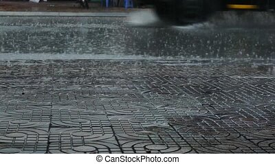 Rain pattering on street in Vietnam - Rain pattering on...