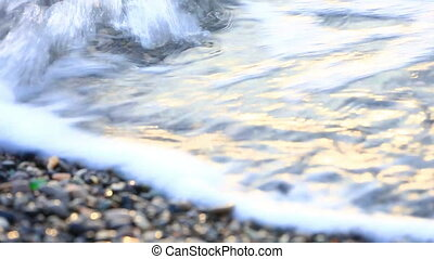 waves run on the stony seashore - Small sea waves run on the...