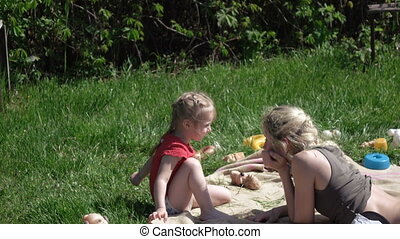 Girl with her mother on picnic