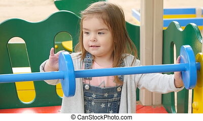 Happy girl on the playground - toddler girl on the...