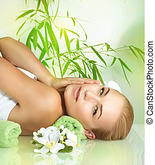 Gentle woman enjoying massage