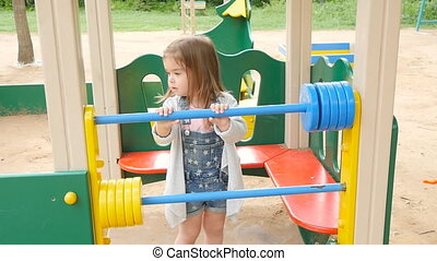 Happy toddler girl on the playground - toddler girl on the...