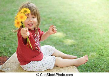 Little girl playing with flowers - Little girl holding posy...