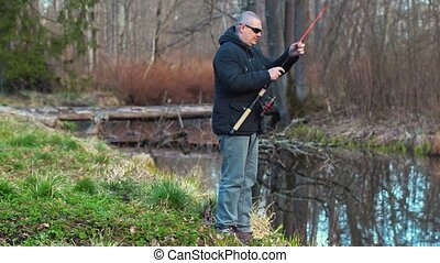 Male cease fishing near river