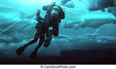 Scuba diving in Arctic at geographic North Pole - Unique...