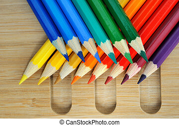Color pencil composition on wooden background - Colored...