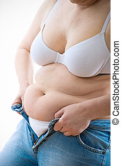 too small jeans - Overweight lady attempting to fasten too...