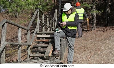 Worker using tablet PC near to