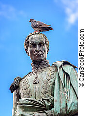 Simon Bolivar Stature - Pigeon standing on the head of a...