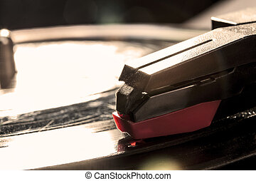Plaing Favourite Song - Closeup to a black pickup with disk