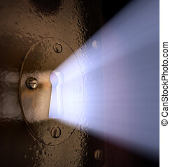 Key Hole - A close-up of light pouring out of a key hole