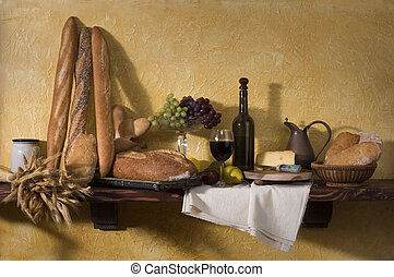 Tuscan Still Life - Bread, cheese, wine and grapes against a...