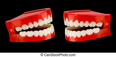 Chatter on black - A pair of toy chattering teeth isolated...