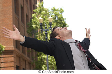 Elated Businessman - Businessman with arms stretched out in...