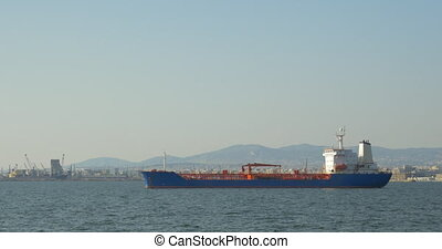 Cargo ship in the sea - Cargo ship sailing in the sea near...