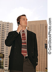 Wheeler Dealer - Business executive on a cell phone outside...